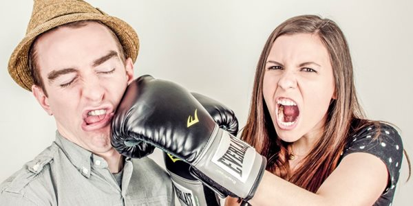 Lady punching a man with a hat